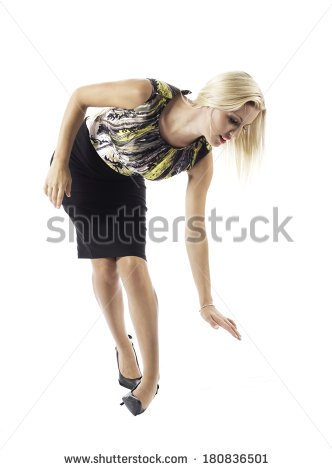 stock-photo-a-young-woman-s-ankle-turns-over-in-her-high-heels-she-reaches-out-as-if-to-prevent-herself-180836501